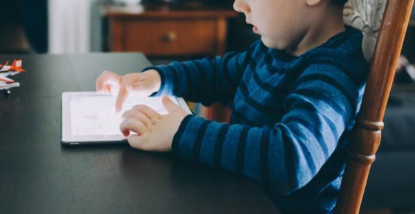 kid looking at screen