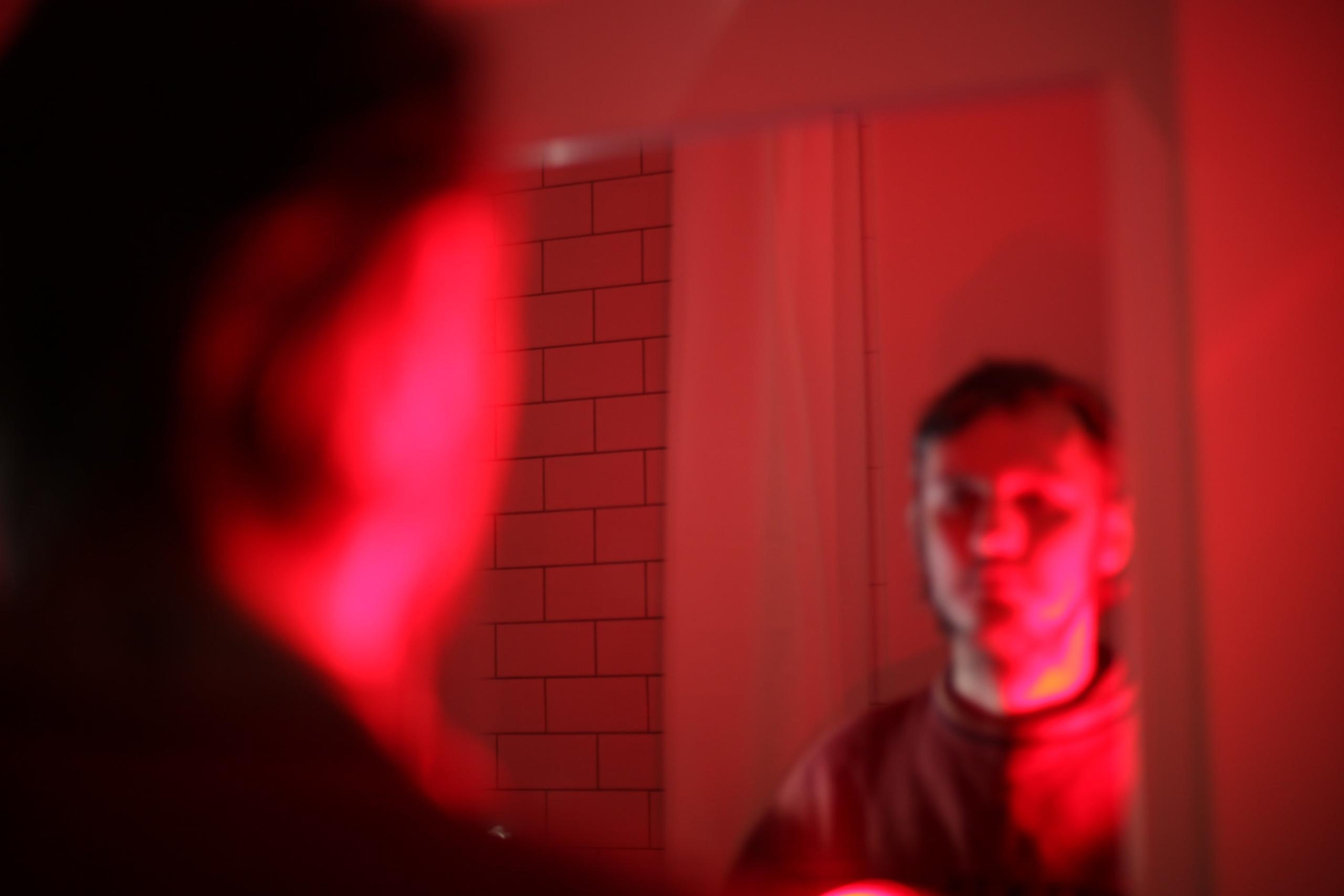 man looking at reflection
