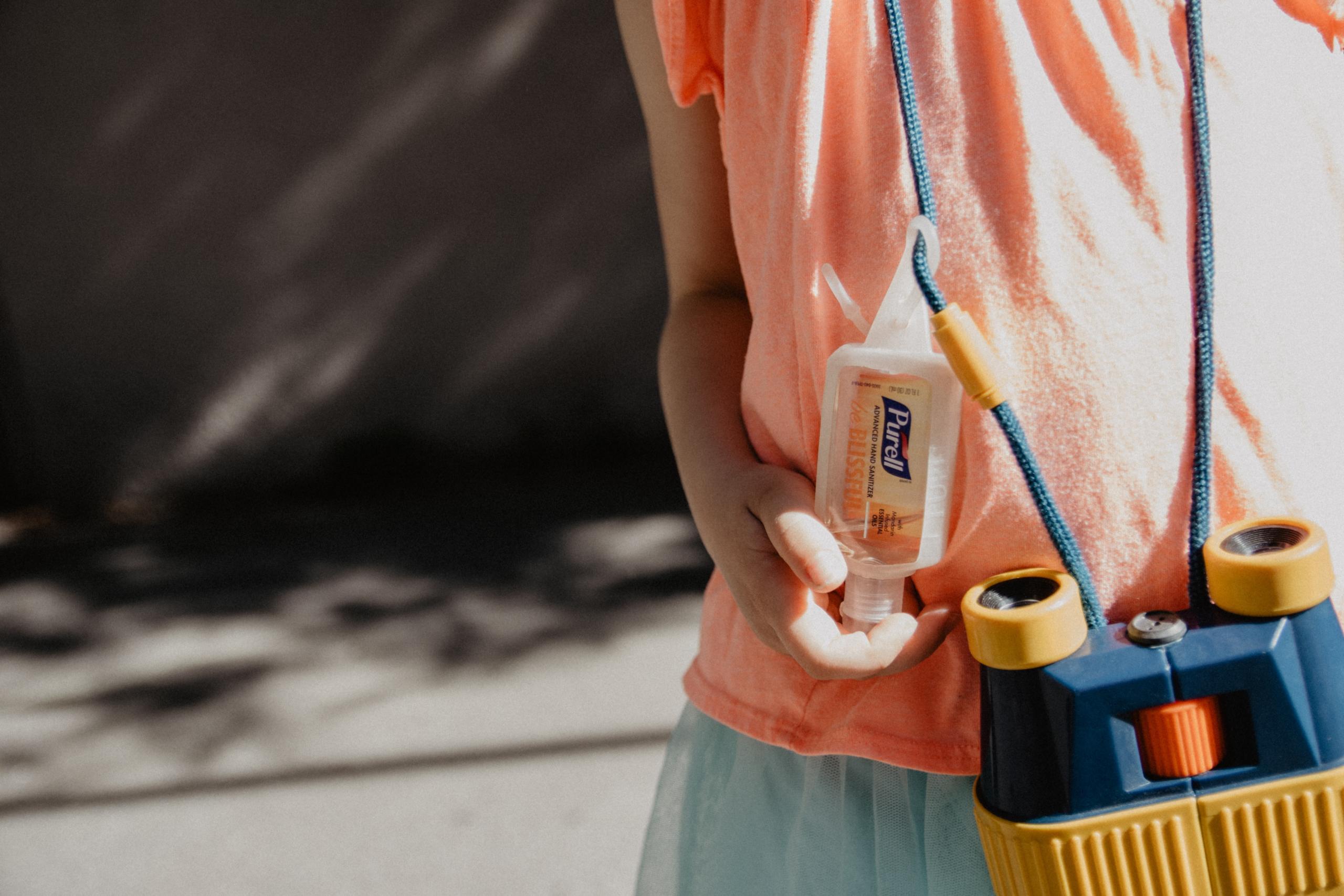 child with sanitiser