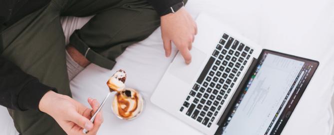 eating next to laptop