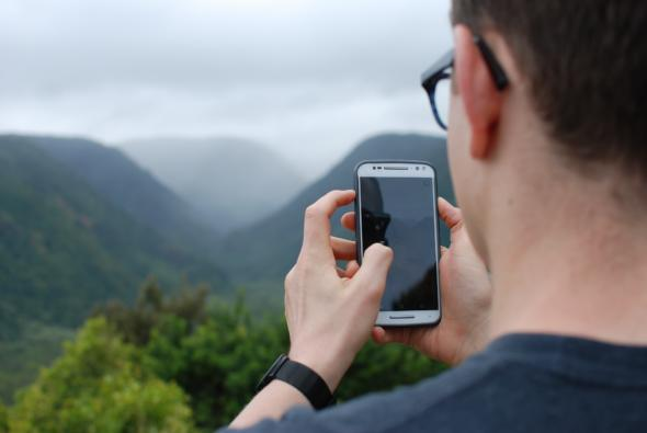 man looking at their phone